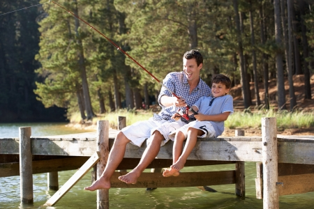 Father and son fishing together Stock Photo - 11238376