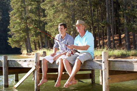 resting rod fishing: Father and adult son fishing together