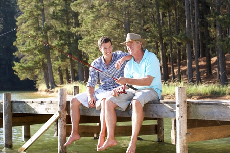 Father and adult son fishing together photo