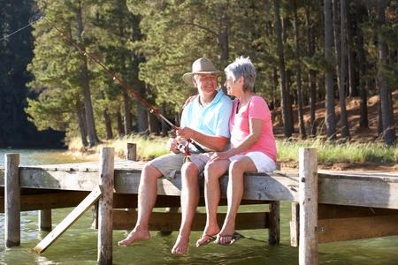 resting rod fishing: Senior couple fishing