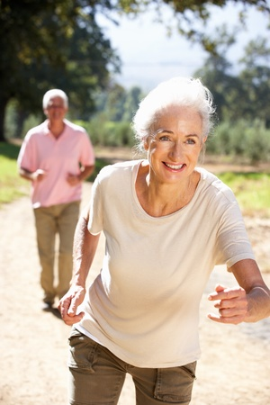 Senior couple on country run photo