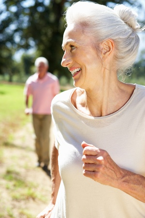 older person: Senior couple on country run