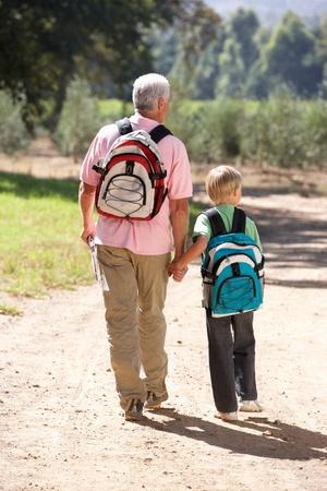 grandad: Senior man and grandson on country walk