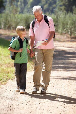 grandsons: Senior man and grandson on country walk