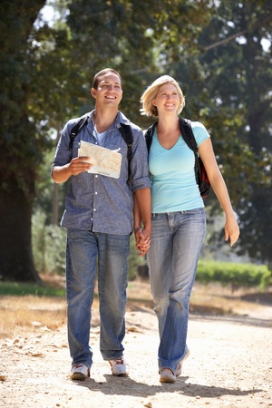 Couple with map on country walk photo