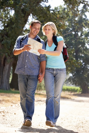 walk in: Couple with map on country walk
