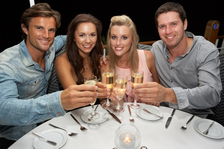 Two young couples in restaurant photo