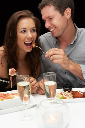 celebrate life: Young couple in restaurant