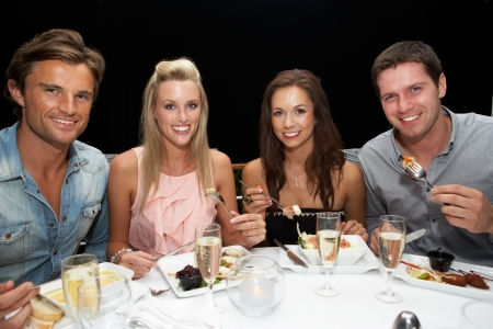 Two young couples in restaurant Stock Photo - 11238254