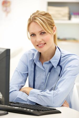 medical services: Young doctor at desk
