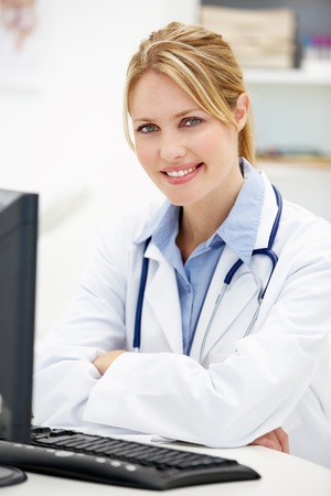 computerised: Young doctor at desk