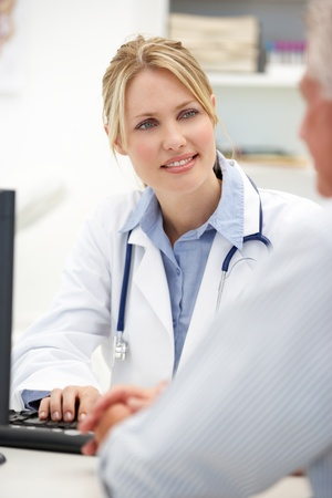 computerised: Young doctor with senior patient