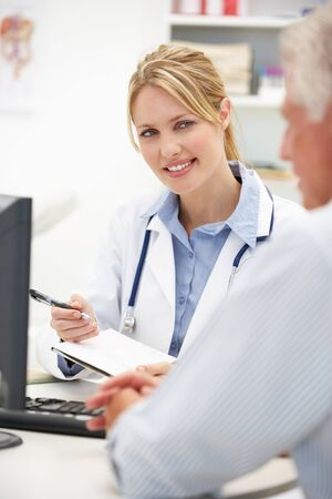 personal record: Young doctor with senior patient