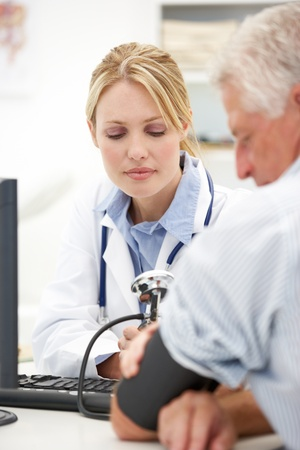 consulting room: Young doctor with senior patient