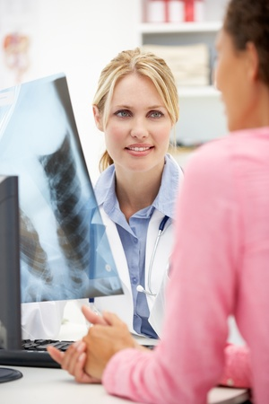 Young doctor with female patient photo
