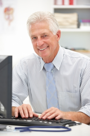 Senior doctor at desk Stock Photo - 11238211