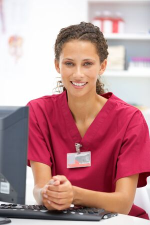doctor's office: Young hospital doctor at desk