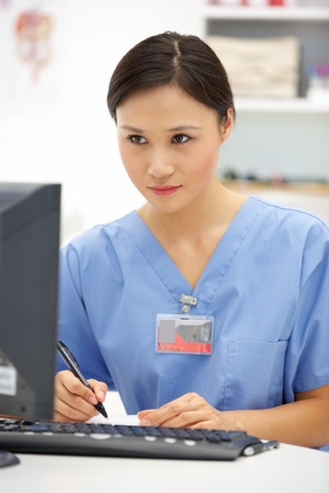 Young hospital doctor at desk photo
