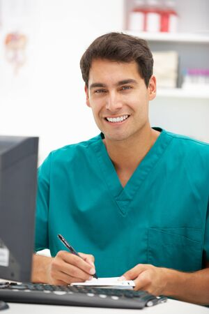 computerised: Young hospital doctor at desk