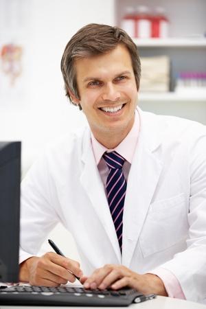 computerised: Hospital doctor at desk Stock Photo
