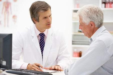 serious doctor: Doctor with senior patient