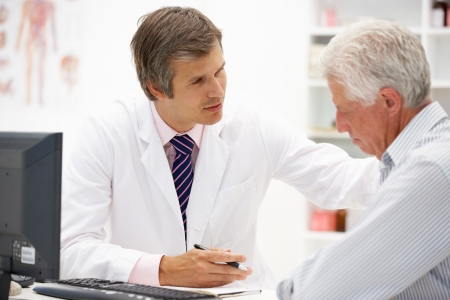 concerned: Doctor with senior patient