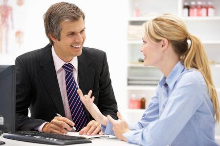 Doctor with female patient Stock Photo - 11238172