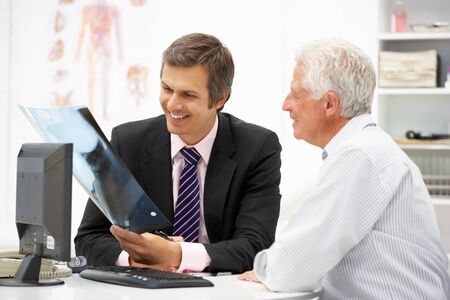 consulting room: Doctor with senior patient