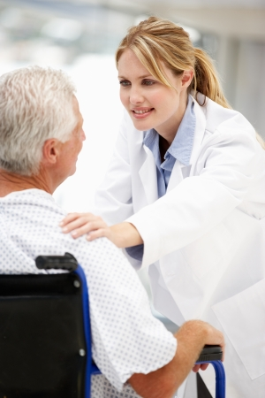 Senior patient with young doctor Stock Photo - 11237846