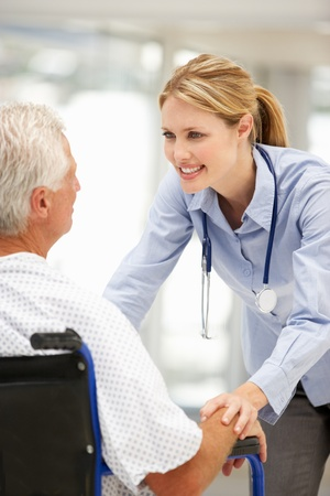 happy patient: Senior patient with young doctor