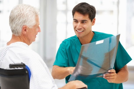 Senior patient with young doctor photo