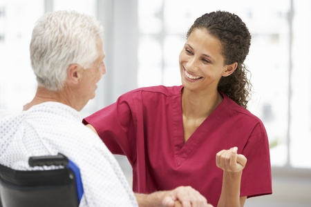 Senior patient with young doctor Stock Photo - 11237860