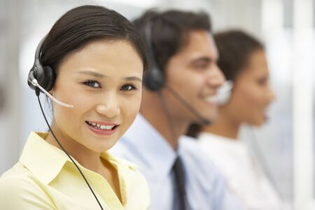 call centre: Businesswoman wearing headset Stock Photo