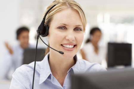call center female: Businesswoman wearing headset Stock Photo