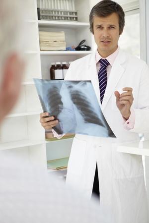 diagnosing: Doctor with senior patient
