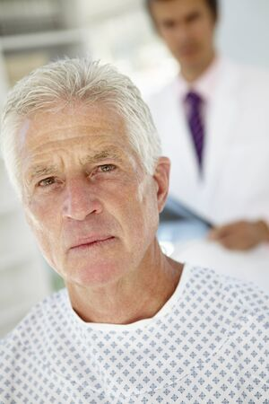 diagnosing: Young doctor with senior patient