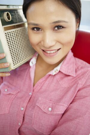 Young woman listening to radio Stock Photo - 11239018