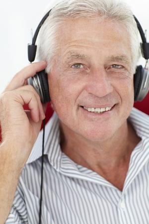 Senior man with headphones photo