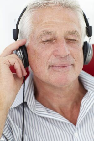 Senior man with headphones photo