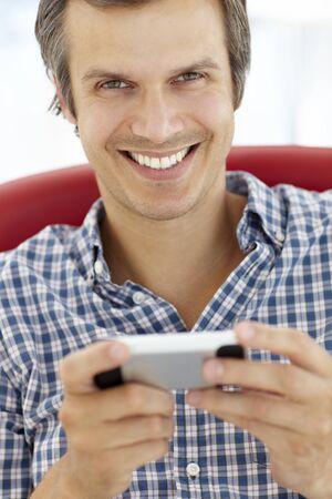 thirties portrait: Man texting Stock Photo
