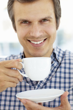 Man relaxing with cup of tea photo