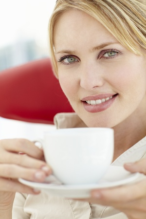 shallow depth of field: Woman relaxing with cup of tea Stock Photo