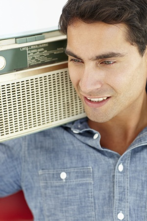 Young man listening to radio photo