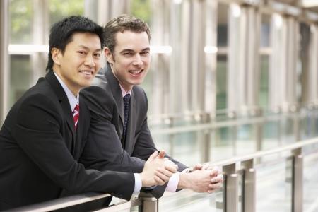 Two Businessmen Outside Modern Office photo