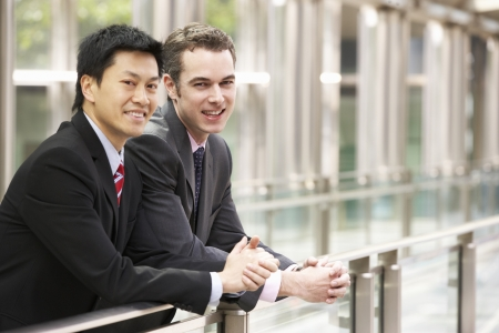 business scene: Two Businessmen Outside Modern Office