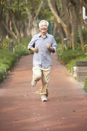 joggers: Senior Chinese Man Jogging In Park