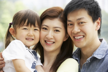 chinese family: Portrait Of Chinese Family With Daughter In Park