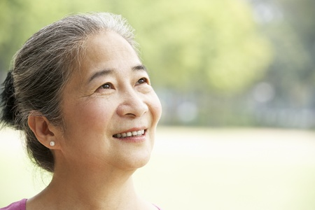 senior asian: Head And Shoulders Portrait Of Attractive Chinese Senior Woman