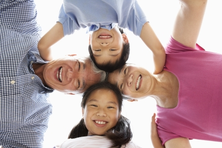 grandchildren: Chinese Grandparents With Grandchildren Looking Down Into Camera Stock Photo