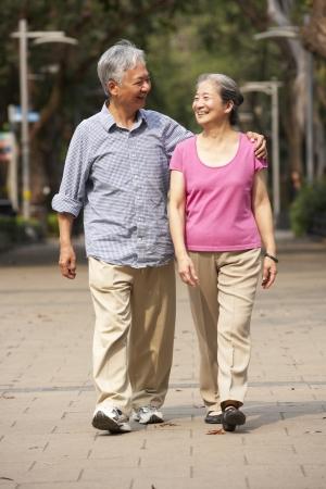 senior asian: Senior Chinese Couple Walking In Park